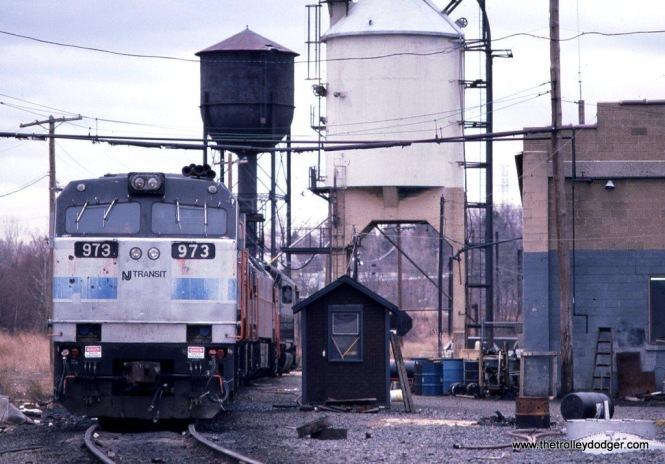 Photo 6. NJT E-60 #973 at South Amboy engine terminal. In 1987 some steam era relics remain, the water column seen in photo 19, and the water tank and coaling tower seen here,