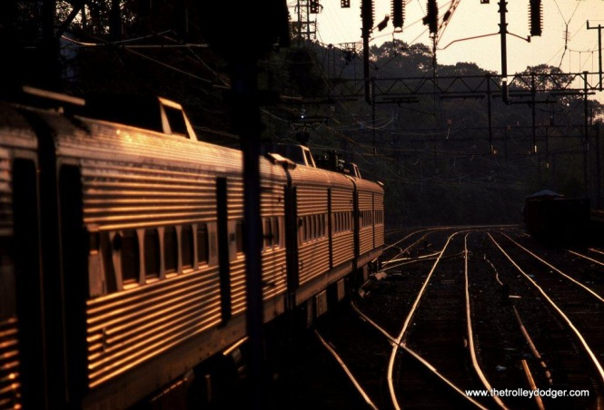 Photo 7. A train of NJT Arrow MUs depart Summit, passing the Hill tracks in 1989.