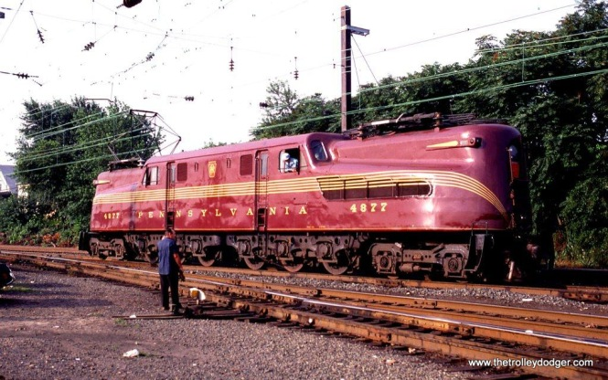 Photo 7. In 1981 NJ Transit restored GG-1 #4877 and painted her in the classic PRR Tuscan red and gold five stripe scheme. She looked great in the summer sunshine at South Amboy, NJ.
