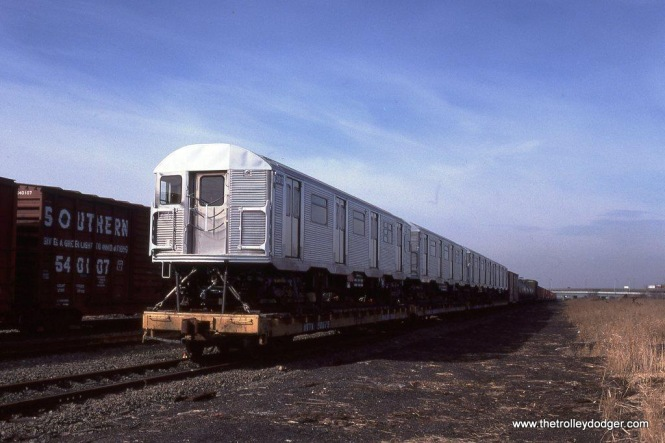 Starting in 1988 and continuing to 1990, NYCTA sent most of the R-32 cars to Morrison Knudsen at Hornell, NY for overhaul. Conrail brought the rebuilt cars loaded onto flat cars down the River Line to Greenville yard in Jersey City, New Jersey. From there the New York Cross Harbor Railroad car floated them back to New York City. On February 13, 1990 several of the rebuilt R-32a cars, including #3613 head out, were sitting in Greenville yard awaiting a boat ride home.