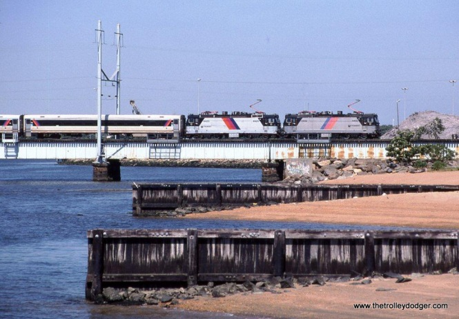 "Photo 8 & 9. NJT ALP-44 #4402 & ALP-44M (for Microprocessor) #4420 crossing the Raritan River on RIVER drawbridge at Perth Amboy. The locomotives are in ""push"" mode on the rear of a southbound train from New York on July 11, 2008."