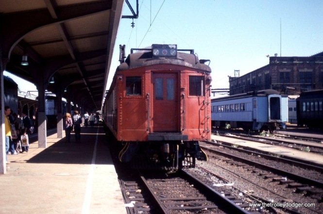 """Photo 8. NJ Transit catenary inspection car #3408 on display at Hoboken Terminal during the """"Hoboken/Try Transit Festival on October 2, 1982. It was originally a DL&W combine. A dome was installed in the roof of the baggage section and a platform with chairs provided inspectors a great view of the wires."""