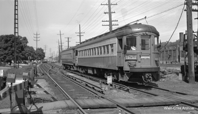 Chicago Aurora & Elgin 433, built by the Cincinnati Car Company in 1927. The tower, just barely visible at rear, was part of Wheaton Yard. (Robert Selle Photo, Wien-Criss Archive)