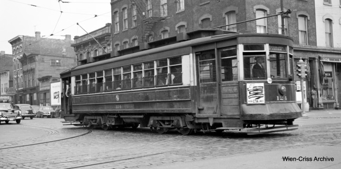 CTA Pullman 124 at Division and Wells on Route 6 - Van Buren. The latest this photo could have been taken is 1951. (Robert Selle Photo, Wien-Criss Archive)