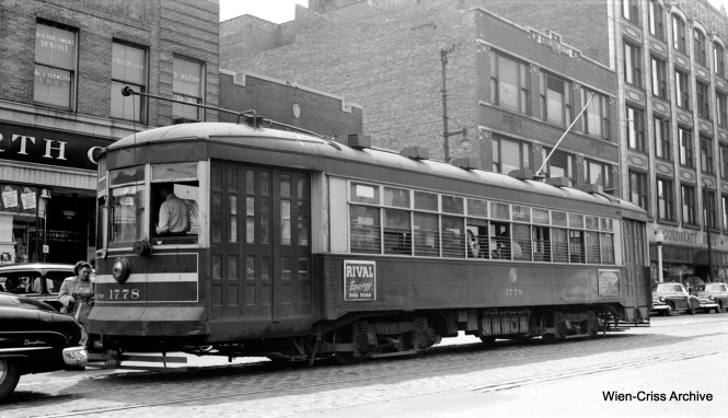 CTA 17778 is on Route 66 - Chicago Avenue at Ashland, passing by a Woolworth's dime store. (Robert Selle Photo, Wien-Criss Archive)