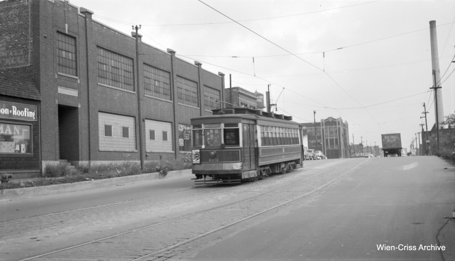 "The note that came with this image of CTA Pullman 469 says it is on Kedzie near Chicago Avenue. But the sign on the streetcar says route 66, which is Chicago and not Kedzie. So perhaps we are on Chicago Avenue near Kedzie. (Robert Selle Photo, Wien-Criss Archive) Patrick Cunningham adds: ""The Pullman 469 photo is on Chicago Ave. looking east from the CNW viaduct towards Sacramento. The building in the far background still exists."""