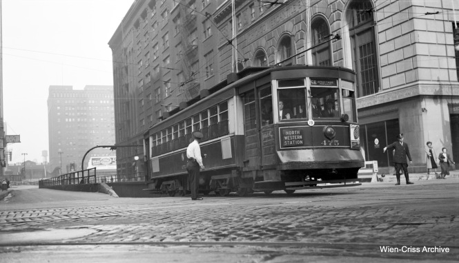 CTA Pullman 475, running on Route 56 - Milwaukee Avenue, emerges from the east portal of the Washington streetcar tunnel at Franklin Street, having traveled under the Chicago River. (Robert Selle Photo, Wien-Criss Archive)