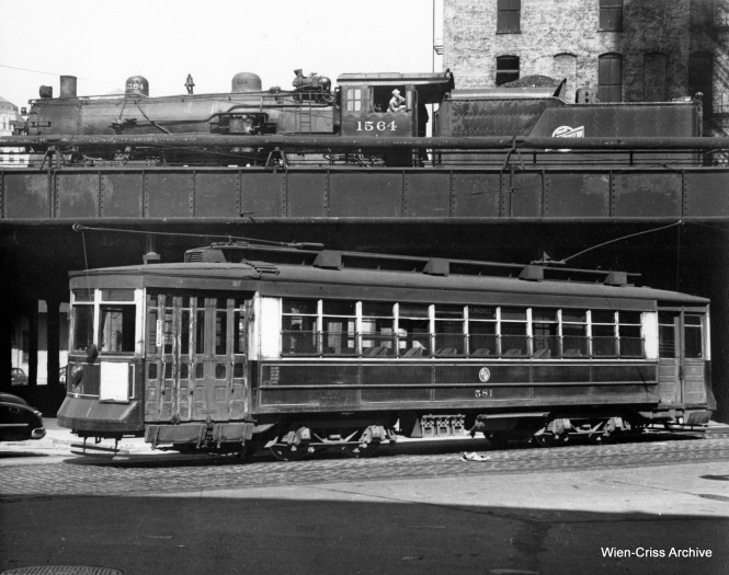 CTA Pullman 581 at Milwaukee and Clinton, in front of Chicago & North Western steam loco 1564. (Robert Selle Photo, Wien-Criss Archive)