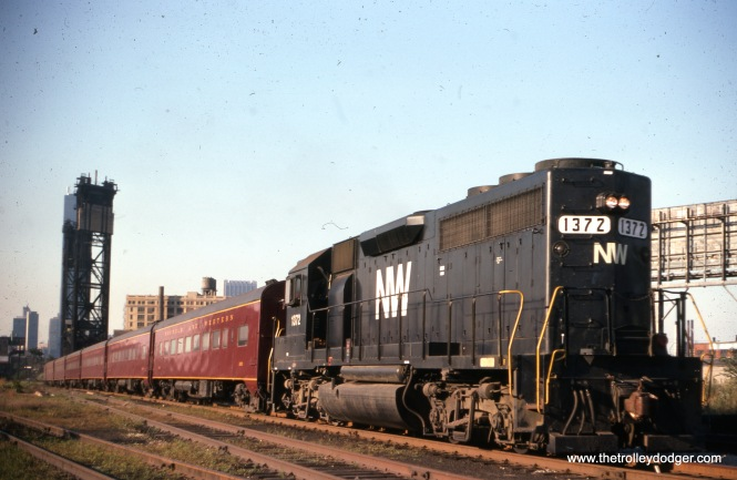 "Loco 137 on an Orland Park local, September 2, 1976. (Joseph Piersen Photo) Bill Shapotkin adds: ""Should be captioned as ""the"" (not ""an""), as at the time of the photo there was but one train each way, Mon-Fri. Additionally, at the time the pic was taken, the train was operating out of the N&W's own Chicago station -- located adjacent (to the west) of the vacant Dearborn Station."""