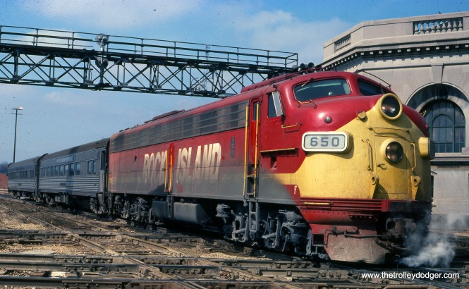 "Rock Island 650 on train #12 to Joliet on March 28, 1976. (Joseph Piersen Photo) M. E. writes: ""If this is indeed CRI&P train 12, the caption is wrong. I plugged ""CRI&P train 12"" into Google and up came the Peoria Rocket. The passenger cars shown were never commuter cars; they were on trains that went farther than Joliet. Perhaps this caption should say, 'The Rock Island's train 12, the Peoria Rocket, arrives in Joliet.' By the way, the Rock Island never turned over its passenger service to Amtrak. After Amtrak formed, the CRI&P ran its own passenger trains from Chicago LaSalle St. station to Peoria (""Peoria Rocket"") and from Chicago to Rock Island (""Rock Island Rocket""). They were never very busy, so they had only one or two cars."""
