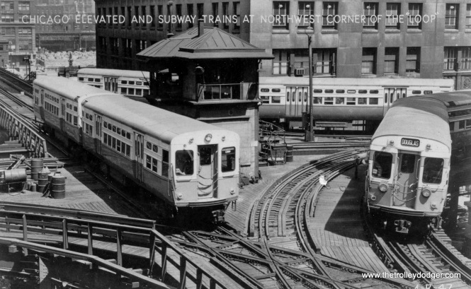 "Three CTA trains of 6000-series ""L""/Subway cars are lined up by the old Tower 18 in the early 1950s. As you can see, with the tower in the middle of the junction, not all moves could be made. For example, eastbound trains coming from Lake Street could not go straight east, but had to turn south. At this time, traffic on both the inner and outer Loop tracks went in the same direction (counter-clockwise). This arrangement was changed in 1969 when the CTA wanted to through-route Lake with the new Dan Ryan line. The tower was moved and replaced with a new one, and new eastbound trackage was built where the old tower was. That was also the beginning of bi-directional operations on the Loop, which continue to this day."