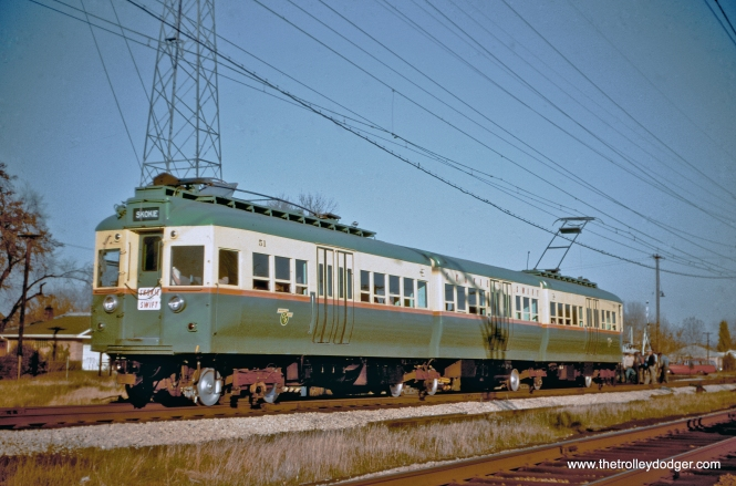 "When the CTA opened the five-mile long Skokie Swift branch in April 1964 (over a small portion of the former North Shore Line) ridership far exceeded expectations. So the four articulated 5000-series cars were quickly renovated and adapted for Swift service. These were experimental when built in 1947-48 and became ""oddballs"" on the CTA system. Here, we see car 51 (renumbered from 5001) in October 1964 at Kostner. These cars continued to run into the 1980s. Two of the four sets were saved, and this set is now at the Fox River Trolley Museum. (Color correction by J. J. Sedelmaier)"