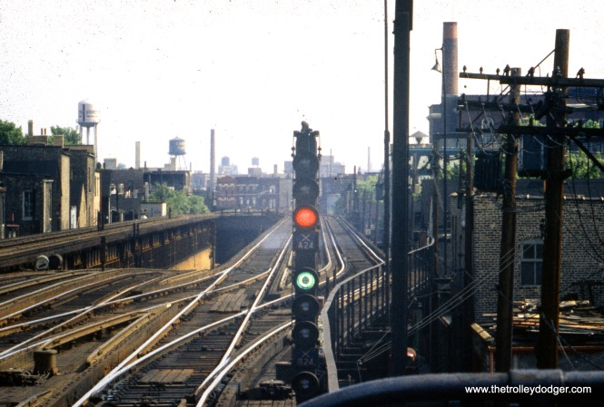 "In the center, we see the portal at the north end of the State Street subway, just south of Armitage. The two middle ""L"" tracks were moved to the outer edge of the structure when the subway was built. The ""L"" continued south from this point with four tracks to Chicago Avenue. In recent years, the two outer tracks have been removed, and just a siding remains at this point."
