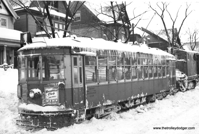 A 900 and a snow sweeper stuck in a drift on West Lisbon Avenue in 1947.