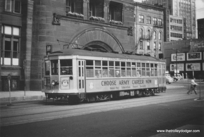 "An 800 series car advertising the benefits of an ""Army Career"" passes Milwaukee City Hall northbound on N. Water Street. (Larry Sakar collection)"