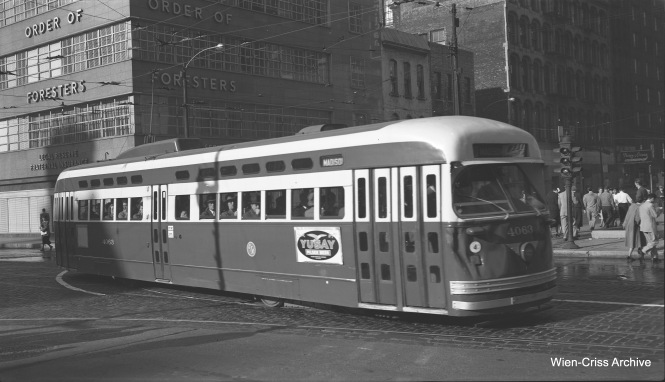 CTA Pullman PCC 4063 is turning from Madison Street onto Franklin on its way into the Loop, running on Route 20 - Madison. In this September 16, 1953 view, car 4063 appears to have suffered some front-end damage that has gone unrepaired. This is probably due to the CTA's desire to scrap these cars within the next year or so. (Robert Selle Photo, Wien-Criss Archive)