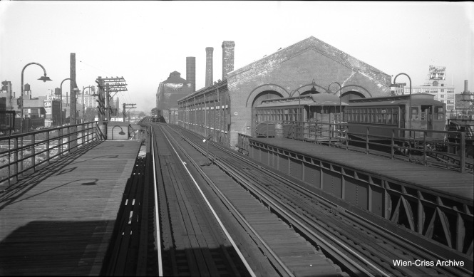 In this September 5, 1953 view, looking west from the CTA Racine Avenue station on the old Metropolitan main line, we see the Throop Street Shops at right. A CA&E train is approaching us, heading toward the Loop. (Robert Selle Photo, Wien-Criss Archive)