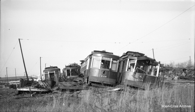 Trolley scrapping: except for a few stragglers, nearly all red cars were scrapped by the CTA after being taken out of regular service on May 30, 1954. On November 6, 1954, we see Big Pullmans 248 and 585 at right, and one of the cars at left is 604 in this scene at South Shops. (Robert Selle Photo, Wien-Criss Archive)