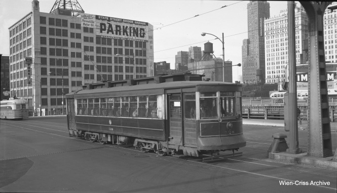 "CTA Pullman 58 is running as a ""tripper"" on Broadway-State on May 18, 1954. Here, we see it southbound on State Street, crossing the Chicago River over the bridge that was put into service in 1949. (Robert Selle Photo, Wien-Criss Archive)"