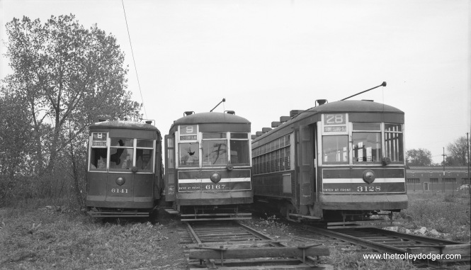 "Three CTA arch-roof cars awaiting scrapping on May 16, 1954: two-man 6141, one-man cars 6167 and 3128 at South Shops. This was just two weeks before the end of all red car service in Chicago, and was also the date of a fantrip that ran on all the lines that were about to be ""bustituted."" (Robert Selle Photo)"
