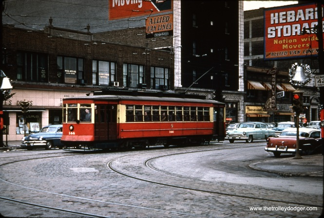 You would be forgiven for thinking this December 18, 1955 photo shows CTA Pullman 144. But this was actually the excursion where car 144 was promised, but 225 was substituted in its place-- renumbered with the help of a few pieces of oilcloth. Here, the fantrip car is seen at Broadway and Devon.