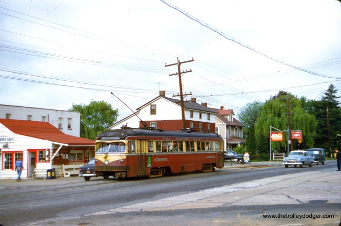 Philadelphia Suburban double-end car 19, which looked like a PCC but does not technically qualify as one, since it had standard interurban trucks and motors. It is captured on May 9, 1954 at Broomall Station on West Chester Pike at Sproul Road in Marple Township, PA. (Edward S. Miller Photo)