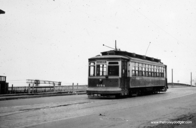 "CSL 5154, signed for Piney and Archer. Bill Shapotkin says, ""This car is at East end-of-line in 26th east of Lake Park Ave -- note IC catenary in background. View looks N/E."" (William Shapotkin Collection)"