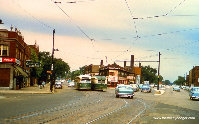 CTA PCCs 7182 and 4380 (or is it 4390?) are turning from Wentworth onto Vincennes at 73rd Street on Route 22. From the looks of the automobiles, this picture may have been taken in 1958. (William Shapotkin Collection)