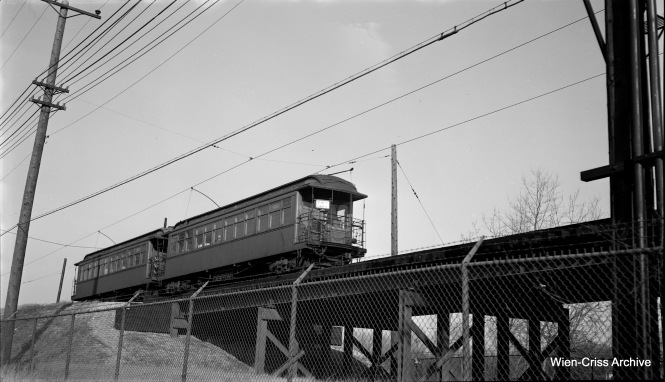 "On November 9, 1952, a two-car CTA ""L"" train, headed by car 1019, is on the trestle at Central on the Evanston branch. (Robert Selle Photo, Wien-Criss Archive)"