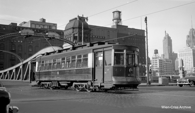 CTA Pullman 230 is southbound on Clark Street, having just crossed the bridge over the Chicago River on May 18, 1954. This was less than two weeks before the end of red car service in Chicago. (Robert Selle Photo, Wien-Criss Archive)
