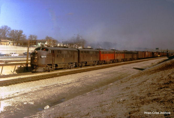The Chicago Great Western Railway merged with the Chicago & North Western in 1968, and most of its trackage was thereafter abandoned. But on February 21, 1965, we see CGW freight #91, running westbound on Baltimore & Ohio Chicago Terminal tracks, parallel to I-290 just west of Lombard in suburban Oak Park, Illinois. The motive power consisted of 104A, 105B, 106C, 116F, 1100, 112C, and 177. At right, you can see the secondary entrance to the CTA's Congress rapid transit line at Lombard. The main entrance at Austin Boulevard is two blocks east of there. The CGW split off from the B&OCT in Forest Park a few miles west of here, and then ran parallel to the Chicago Aurora & Elgin interurban through Bellwood. (James J. Buckley Photo, Wien-Criss Archive)