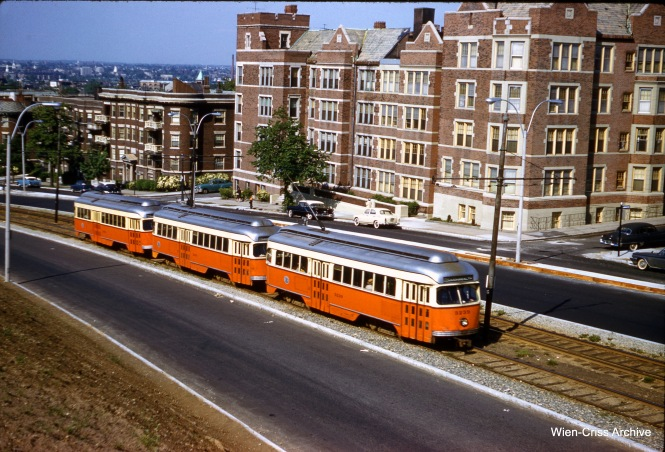 A three-car train of Boston MTA PCCs, running on Commonwealth Avenue east of Summit Avenue on May 31, 1961. (Clark Frazier Photo, Wien-Criss Archive)