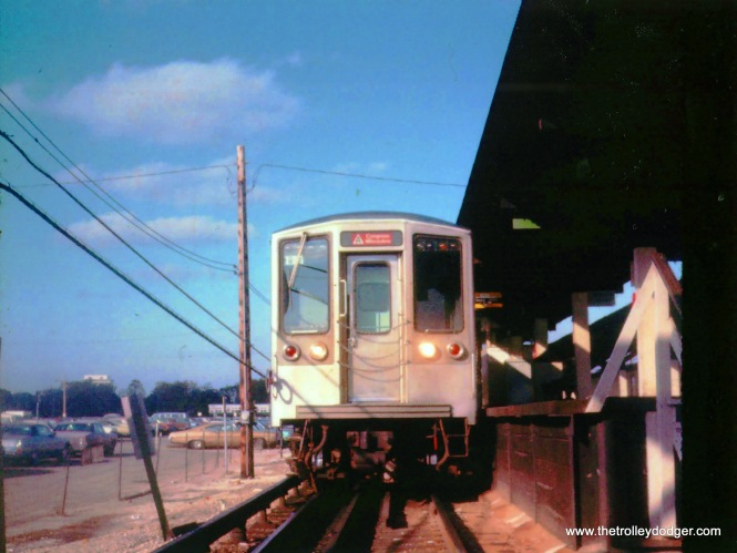 I took this photo at Des Plaines Ave. Forest Park on what was then the West-Northwest Rapid Transit line probably in the summer of 1972. I was standing on the blacktopped walkway to the parking lot and crouched down to get a view looking up at what was then one of the relatively new 2200 series cars.