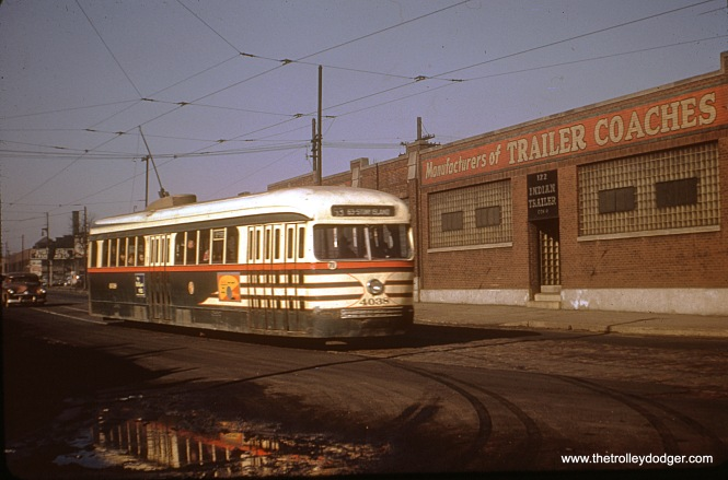 CTA prewar PCC 4038 is eastbound on 63rd Street. PCCs ran on this line between 1948 and 1952. If the address on the building is any guide, this is probably 122 East 63rd Street.