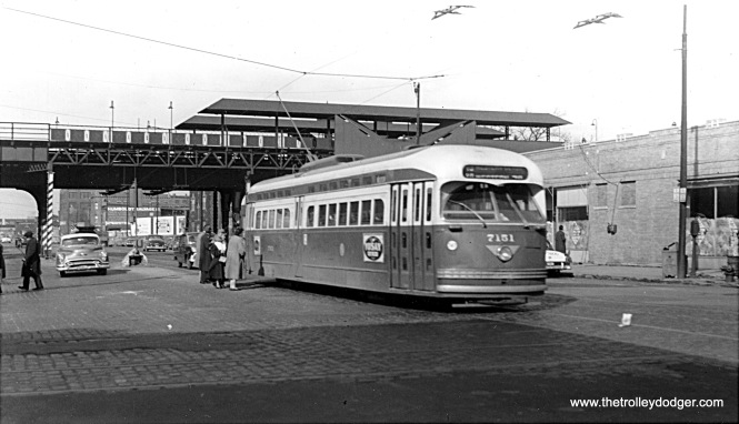 "CTA PCC 7151, a product of St. Louis Car Company, heads south on Route 49 - Western at North Avenue in 1953. The ""L"" station behind it was part of the Humboldt Park branch, which was abandoned in 1952. Once the station was closed, signs advertising ""L"" service were removed although I don't believe this portion of the structure was removed until the early 1960s. Note that riders at this safety island are boarding at the rear, as this is a two-man car."