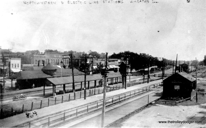 "The caption here reads, ""North Western and electric lines stations, Wheaton."" The CA&E is in the foreground. The photo is not dated, but it must be quite early."