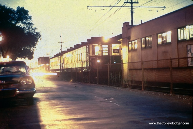 In September 1959, we see a two-car train of CTA 4000s, preparing to head east. I believe the location is Marion Street in Oak Park and not Marengo Avenue in Forest Park as written on the slide mount. Marengo is a short distance west of Harlem, and although Lake Street trains did go there, the buildings in this picture match Marion. We have another picture in this post showing what the area west of Harlem actually looked like. (William Shapotkin Collection)