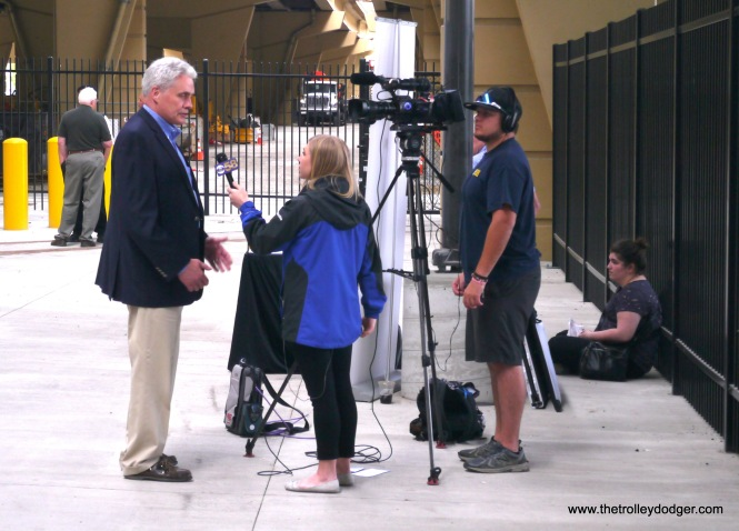 Local news reporters interviewing Alderman Bob Bauman, a strong streetcar supporter.