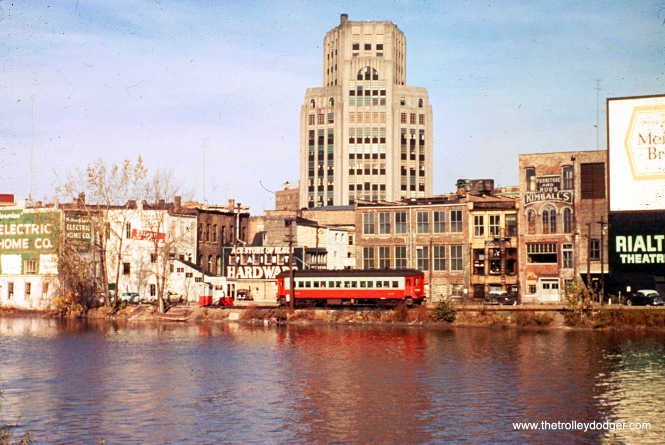 This Chicago, Aurora & Elgin image is from an original 1950s Kodachrome slide that was not processed by Kodak. I am not quite able to make out the car number, but it looks like it is one of the 420s. The location is downtown Elgin, along the Fox River. The Rialto Theater burned down in 1956.