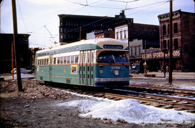 CTA PCC 4366, a Pullman, heads north on diversion trackage on Halsted at Congress in 1950. This was necessitated by construction of the bridge that would go over the Congress expressway (now the Eisenhower, I290). Bridges that crossed the highway were the first things built, since t