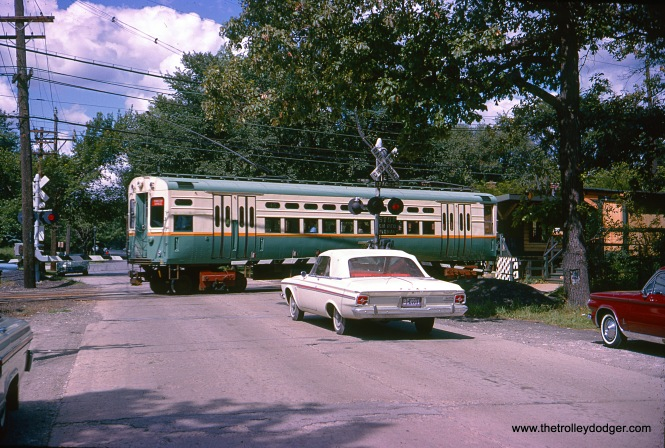 On August 13, 1964 CTA single-car unit 45 prepares to stop at Isabella station on the Evanston line. The car is signed as an Evanston Express, but I do not think it would have operated downtown as a single car. Therefore, it must be in Evanston shuttle service. (August 13, 1964 was a Thursday, so the Evanston Express was running that day, though.) (Photo by Douglas N. Grotjahn)