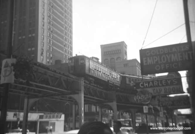"A two-car train of CTA 4000s, running on the Lake Street ""L"", are at Wabash and Van Buren on the Loop. In the background, you can see the Auditorium Theater building."