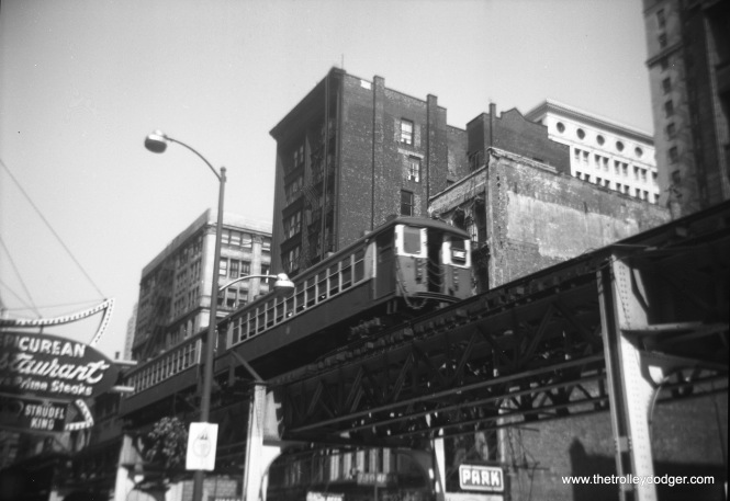 The old Epicurean restaurant, at left, was located at 316 S. Wabash and served Hugarian cuisine. A CTA Lake Street train rumbles by above.