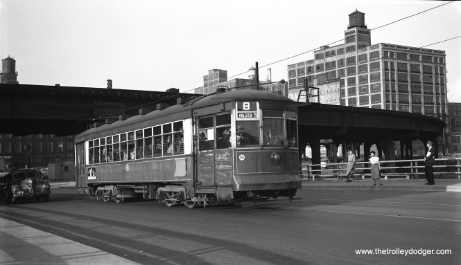 "CTA two-man arch roof car 3189 is southbound on Halsted Street near the Garfield Park ""L"" overpass, south of Van Buren Street on September 17, 1953. As had previously happened with 63rd Street, PCCs had been taken off this route and replaced by older red cars for the final few months of service. 3189 is on the bridge that would eventually go over the Congress expressway, which was then under construction. (Robert Selle Photo)"