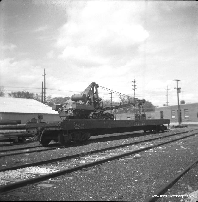 A crane on a CA&E flat car. This appears to be Wheaton Yard.