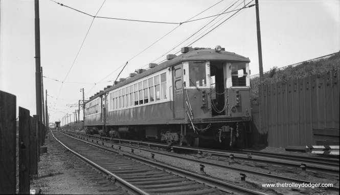 "Photographer Bob Selle notes: Two-car ""L"" train (4420 at right) on Lake Street line just west of Harlem Avenue."" In the distance, you can see the actual terminal. Not that many people boarded there, compared to the Marion Street station just east of Harlem Avenue. This picture was taken on May 1, 1955."
