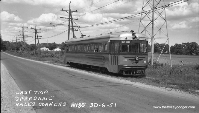 "This photo purports to show the actual last run on Milwaukee's ill-fated Speedrail interurban on June 30, 1951. However, according to Larry Sakar, author of Speedrail: Milwaukee's Last Rapid Transit?, ""The last run to Waukesha which left Milwaukee at a little after 8:00 pm and returned to Milwaukee at 10:08 pm, 2 minutes ahead of schedule, was handled by duplex 37-38. The final round trip to Hales Corners was handled by curved side car 63, not 66. 66 did run on the last day, but it was by no means the final run."" Chances are this photo was at least taken on the last day. The line could not survive the repercussions of a terrible head-on collision in 1950, and Milwaukee area officials wanted to use the interurban's right-of-way, which it did not own, for a new highway. Don's Rail Photos: ""66 was built by Cincinnati Car in August 1929, #3025, as Dayton & Troy Ry 203. It was returned to Cincinnati Car in 1932, and in 1938 it was sold to Lehigh Valley Transit as 1102. In 1949 it was sold to Speedrail, but was not rehabilitated until March 1951. But it only ran for 3 months before the line was abandoned and then scrapped in 1952."" (Photo by George Harris)"