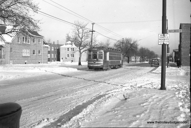 "This picture of CTA one-man car 3236, taken on January 14, 1950 shows it crossing Maplewood Avenue on what is obviously an east-west trolley line. John F. Bromley, who sold me this negative, was unsure of the location. Jeff Wien writes, ""I would guess that it is at 71st & Maplewood. Bill Hoffman lived all of his life at 6664 S. Maplewood which was a half mile north. Maplewood is a block or two west of Western. Route 67 covered 67th, 69th and 71st as far west as California (2800). Maplewood is around 2600 West. Check out the streets to see if I am correct. The one man cars were used on route 67."" Looks like Jeff is correct, as further research shows that the house at left is still standing at 7053 S. Maplewood."