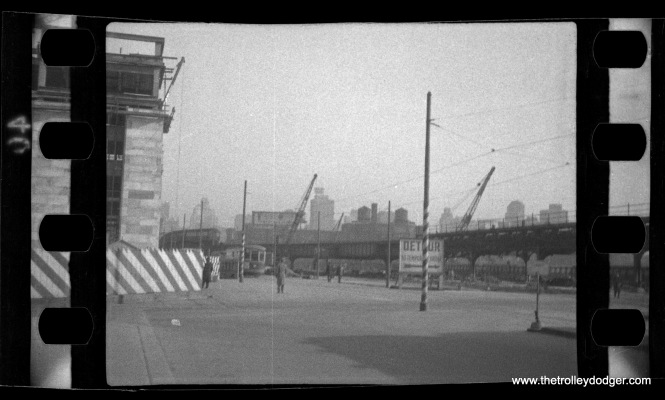 "This picture, which could be as old as the 1930s, was listed by the seller as being Chicago. However, I have my doubts, as I am unable to think of a location this could be around here, or what the construction project might be. The sign says ""Detour to temporary bridge."" Jeff Wien thinks this might be Philadelphia."