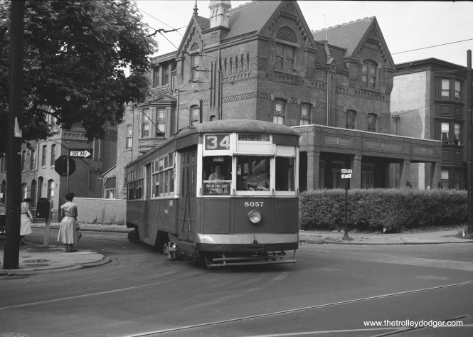 "PTC ""Peter Witt"" 8057 was built by Brill in 1923. Here it is seen on Route 34 in the 1950s. Michael T. Greene writes: ""The picture of the Route 34 Peter Witt was taken at 38th and Locust Streets, on what's now the campus of the University of Pennsylvania. (An alum now resides at 1600 Pennsylvania Avenue, NW, in Washington, but enough of that!). The trolley is using detour trackage onto Locust Street EB, as part of the subway-surface extension of the 1950's…westbound trackage continued on Locust to 40th Street, where it hung a left turn. Today, 38th Street has been widened to a 2-way street, but still with a trolley track, used as a diversion route for subway-surface Routes 11, 13, 34, and 36. Locust Street was been turned into a pedestrian walkway, and a pedestrian bridge goes over 38th Street these days."""
